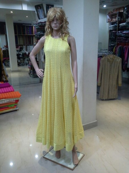Long gown in net ffabric yellow colours  .available in other colours. - by Sheetal Exclusive, Hyderabad