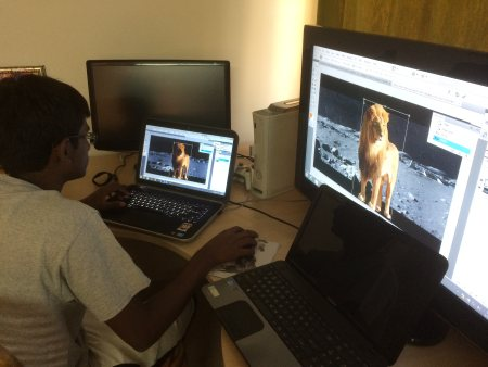 Here's Rahul learning to Photoshop a picture of a Lion onto the surface of the moon :) - by The Roachshala, Hyderabad