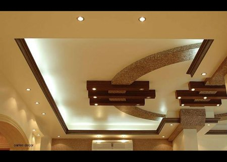False Ceilings .  False ceiling is often a secondary ceiling, hung below the main (structural) ceiling. It may also be referred to as a drop ceiling and is a staple of modern construction and architecture. - by Sai vikas interiors and exteriors, Hyderabad