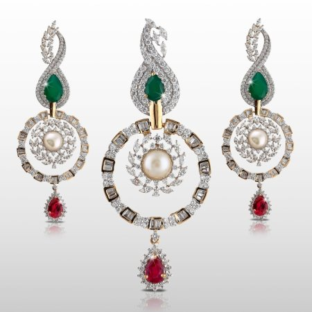 A Beautiful Heavy Pendant Set Studded With Round Cut Diamonds With A Hint Of Marquise, Tappers & Baguettes. A South Sea Pearl Studded In The Centre, An Emerald Set At The Top And A Ruby Attached As The Droplet. This Is A Stylish Piece To Go - by MSJ Diamonds, Hyderabad