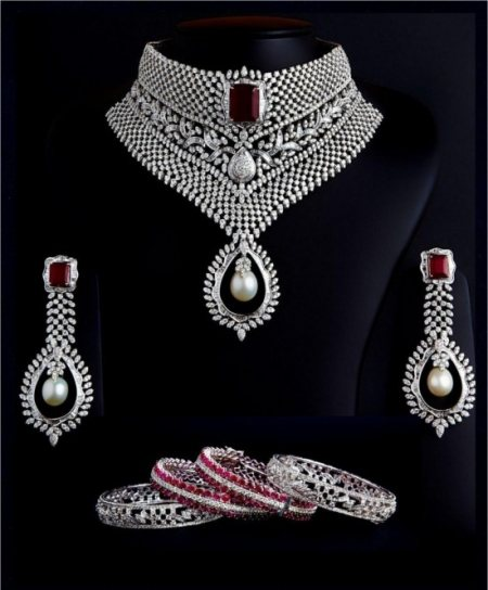 A Multi-Wear Diamond Choker Set Studded With Round Diamonds, Tappers & Baguettes, Rubies And A South Sea Pearl Added As A Droplet With Matching Designer Ruby & Pearl Diamond Earrings And The Exclusive Matching Designer Ruby & Diamond Bangle - by MSJ Diamonds, Hyderabad