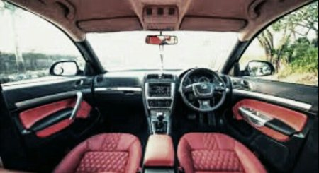 Custom make interiors to your preference and fit. Bloody red Skoda  - by Exvin - Custom Cars N Bikes, Hyderabad