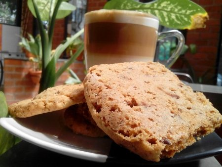 Soul square cappuccino with soul square signature complement cookie....