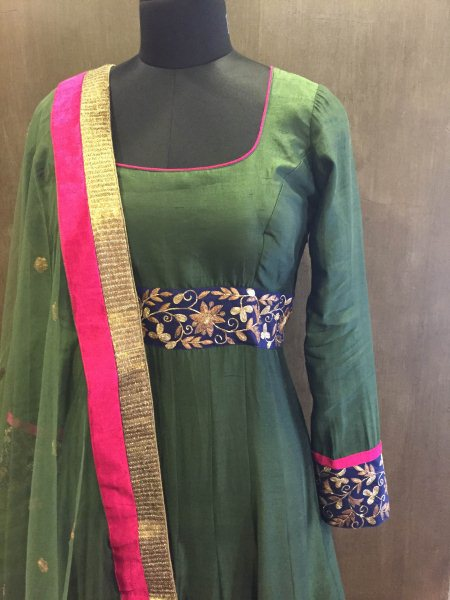 Mehendi green silk Anarkali with hand embroidery  - by Preet Mangal, Ahmedabad