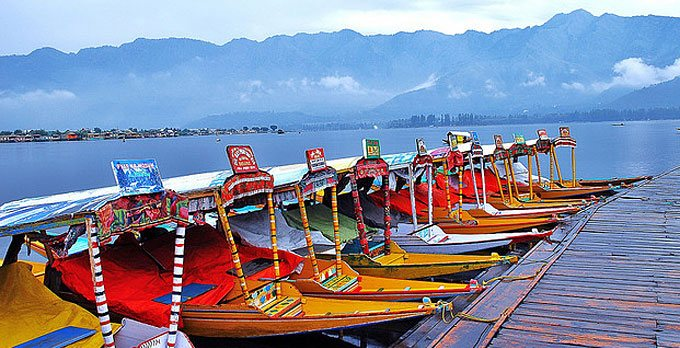 """Paradise on the Earth"""" Kashmir offering serenity of Dal Lake and panoramic view of hills covered with pine trees & Houseboats besides the Dal lake which has  dazzling view at its backdrop. It is one of the most beautiful and romantic desti - by Ghoomloduniya, Delhi"""