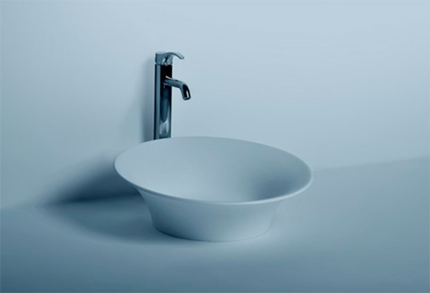Corian counter top wash basin of round shape to add luxury look to your bathroom. - by Dooa Sanitaryware, Hyderabad