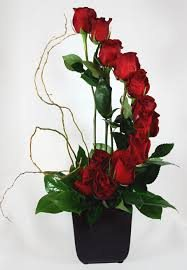 Beautifull red roses arranged in curve shape in a basket.  - by Kusum Florist, Ahmedabad