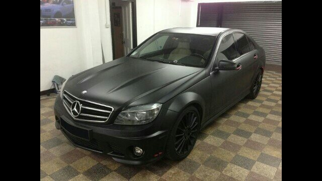 your car now without painting mercedes c class wrapped with matt finished black wrap..