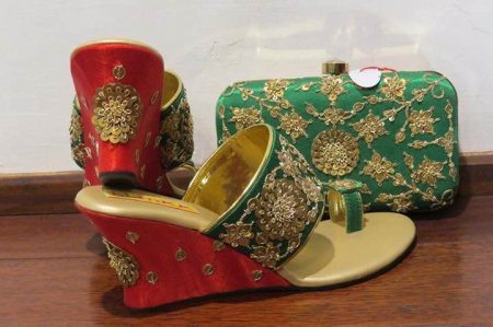 Red- Green Sequenced Floral inspired footwear and box clutch.  A perfect combination of footwear and box clutch for all the brides to be!  Code:- TKW-80 Box clutch:- BCKW-19