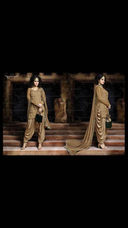 Designer suits in karol bagh   Grab this exclusive semistiched strait suit with patiala salwar and a beautiful dupatta .  To buy www.purisonline.com   - by Puri's Online, Delhi