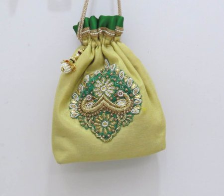 Gold and Green-A perfect traditional combination! Gold Zardosi Work Potli with a hint of Green!