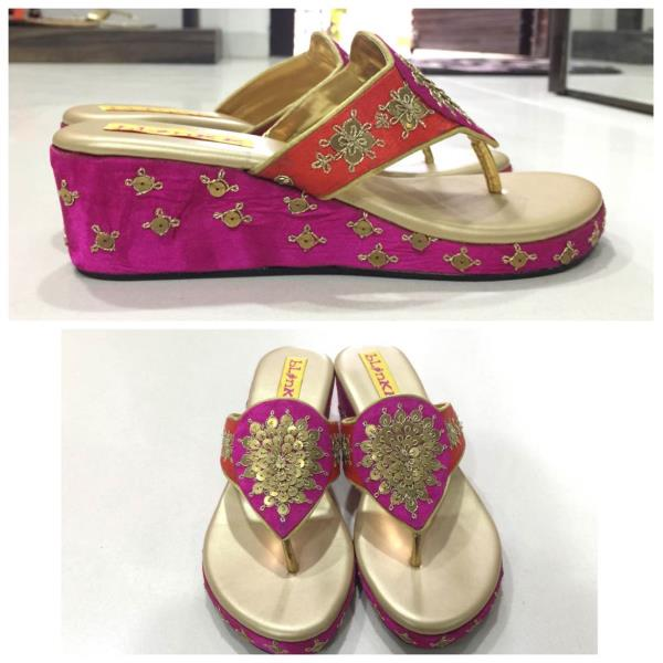 A beautiful and comfortable pair of designer footwear.  Marodi work orange and pink Platforms.