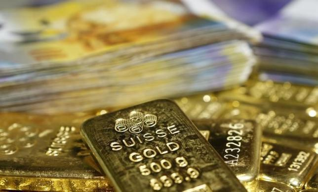 Gold retreats as equities rally, oil bounces 8 percent