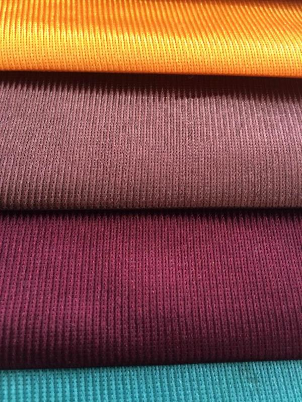 Poly bright fabric used in track suits, bags, dresses, curtains Its a polyester warp knitted fabric