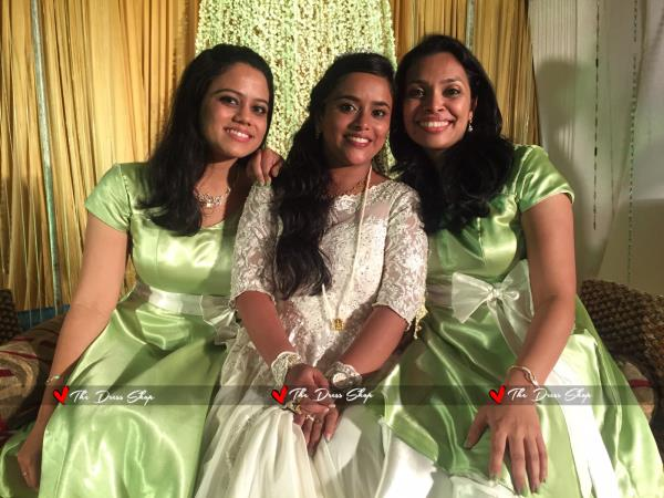 Our bride Sunita in a customized Bridal Gowns made with <3 at The Dress Shop.., Her Bridesmaids in sync in dresses made of pistachio Satin.  - by THE DRESS SHOP, Chennai