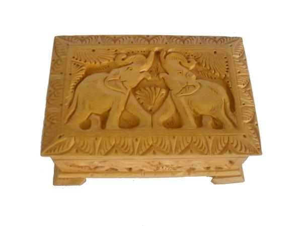 A rectangle shaped decorative, wooden jewellery box handcrafted from cedar wood, adorned with two elephants carving on the top of the box . Wooden Jewellery box   to store all your precious jewelry like earrings, toe rings & cufflings or anything which is precious for  keeping safe. Use it to adorn your dressing table or any corner table of your choice.