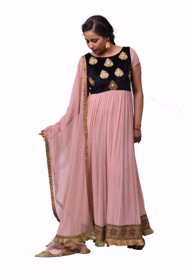 Beautiful Pink Anarkali suit with embroidered gold motifs on the bodice. For further enquiries kindly call us on 9030667888. or drop us an email @ prashantikumar18@gmail.com - by Rouge by Prashanti Kumar, Hyderabad