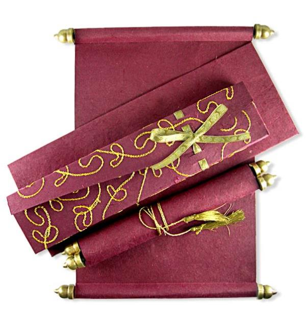 The Scroll Card Is Encased In A Very Attractive Bronze Container With Traditional Engraving Work Done On It. Scroll Wedding Cards in Delhi, Scroll Wedding Invitations in Delhi, Scroll Wedding Invitations, Scroll Wedding Cards in Delhi, Box Scrolls in Delhi.