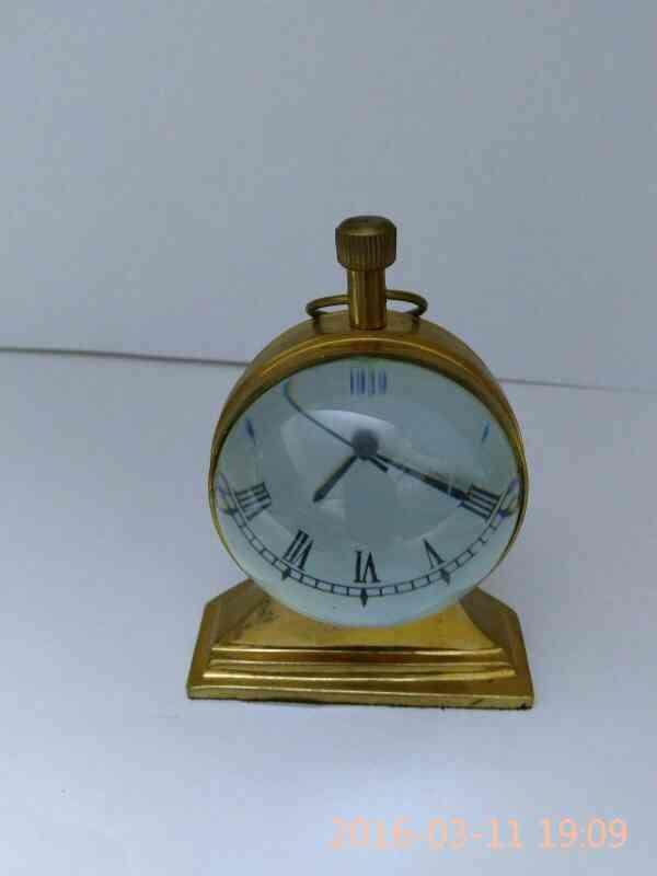 Antique trophy shape table clock