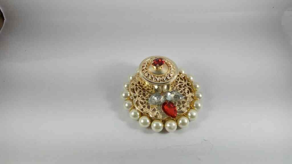 Beautiful Kumkum Boxes studded with stones and pearls. ideal as Return Gift Item. for this and many more Puja Items Online logon to www. pujacelebrations.com