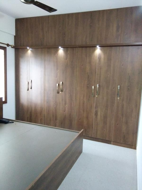 wardrobe finished with ply laminate master bed room by  V Zone interiors