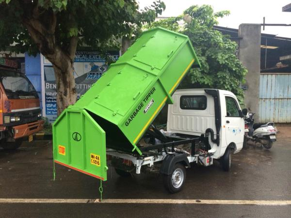 Closed body tipper used for collection of garbage. Dc power pack operated developed on mahindra maximo.