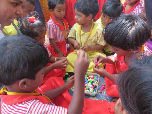 Who can pick the same colour beads? - by OPEN ARMS International School, Hosur