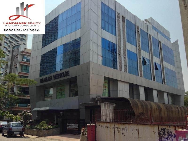 Glass Facade Commercial Building Located At A Very Prime Location Of New Link Road, 10 Min From D.N Nagar Metro Station, Andheri West. The Premise Is Fully Furnished With 1 Cabin, 8 Workstations, Self Contained. Ideal For Corporate Offices, - by LANDMARK REALTY, Mumbai Suburban