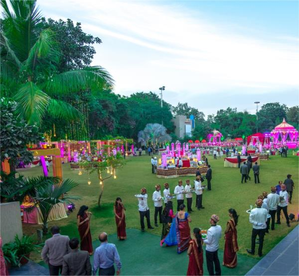 Lawns at Narayani Heights have been blessed with beautiful luscious gardens and pleasant weather. Keeping in mind the size of these gorgeous area, Narayani Heights offers a thriving location all types of events from small intimate affairs to a large and lavish wedding function. The international feel and cosmopolitan appeal makes these lawns a great spot for destination weddings. Party Lawns of Narayani are one of the largest gardens available for wedding venues in Ahmedabad. With a capacity of 500-2, 000 pax, Lawns of Narayani Heights is an ideal venue to host your dream wedding. . Plan your Dream Wedding Destination at Narayani Heights For Bookings  +91 9227257598