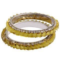 Buy Designer Kadas online  The yellow Designer Kada with a Beautiful Design is all yours.Wear it on simple occasion or a grand one Its all upon you Carry it according to your own style anytime and anywhere.  To purchase visit: www.shoppingbangles.com