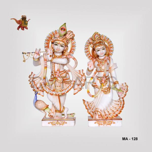 Marble Radha Krishna Statue  The hand made marble Radha and Krishna statue comes with a set of two different idols. The Krishna standing on a platform holding a flute with a peacock by his side is accompanied by the Radha statue.   The product code is MA-128 and available sizes are 15, 18 and 21 inches.   The Marble idols are perfect for Worship as well as for Home Decor.   Our company manufacture handicraft in wood, marble and metal. We are serving domestic as well as domestic markets. CMT ARTS is renowned for Indian handicraft