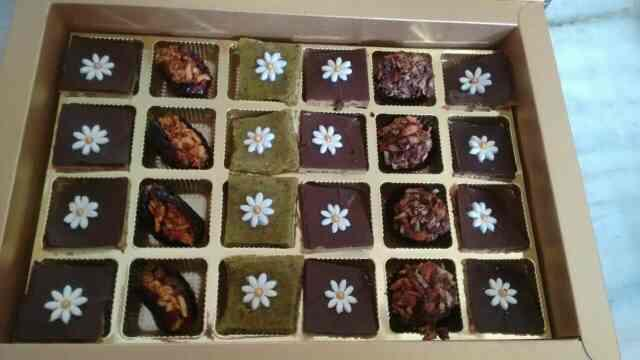 assorted gift pack of walnut delight , pistachio bites, stuffed dates, n hazelnut truffles, only  the best fudge makers, designer chocolates, n sweet manufacturers, only at Ahmedbad, Gujarat India bookings open for bulk orders, available in - by Rashis Fudge, Ahmedabad
