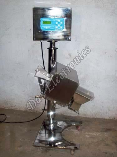 Capsule Metal Detector  If you are looking for the best Pharmaceutical Metal Detectors Exporters in India, then Das Electronics is a name for you. The company is counted among the major Capsule Metal Detector Manufacturers, Exporters and Suppliers in India. Designed for excellent performance, the Capsule Metal Detector, provided by the company, is used for detecting metals at varied locations. Our Tablet Metal Detector is indigenously developed and features customized software to provide up-to-date record for all products and for validation of machine.   This Metal Detector is surely the right choice to rely upon and lines us up among the leading Metal Detector Exporters in India. This equipment is especially manufactured in compliance with CGMPs standards by making use of the best SS 304. Further, all the non-metallic parts of these detectors are made of Food Grade materials for ensuring safety of the people. Not only this, this metal detector comes with easy height adjustment operation.  Attributes Precisely designed Reliable performance User friendly Easy to clean  Features Full construction compliant with CGMPs is made of SS 304 The non- metallic parts is made of Food Grad materials Reject mechanism is De-attachable type and it can be wash with water Reject mechanism uses 24VDC for 100 % duty cycle Very high through output- 5000 to 7000 Tablet /Capsule per minute depending on the size & shape Very easy height adjustment operation The system can be rotated 360° at a place Reject Bin is attached with system 4X20 character LCD display with back light Audio and visual indication on metal detection The System will have 100 products memory. It can be set 00-99 3 level of security code i.e. General mode, Supervisor mode, Administration mode Sensitivity and other parameter can be set by touch key pad Product effect compensation Auto validation facility Food grade non-metallic white chute having authentication certificate designed such way that it can be easily cleaned C