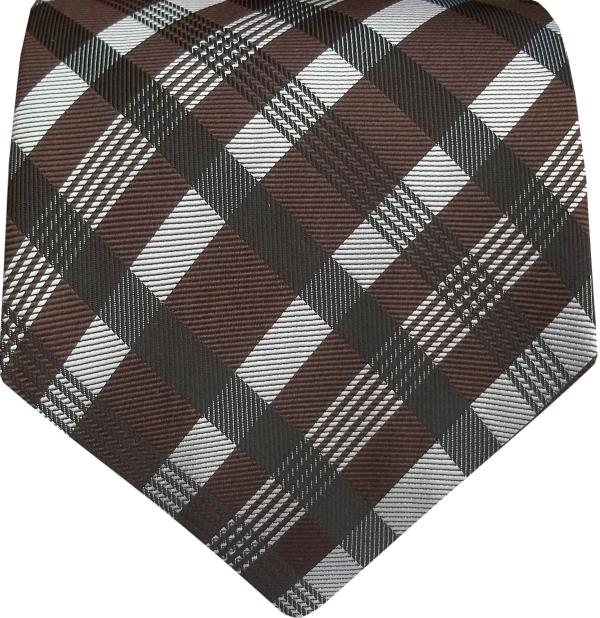 Silk Ties  Silk Ties In A Check Design Of Gray And Black Gives An Outstanding Looks Which Increases Its Grace. We Manufacture All Kinds Of Silk Ties In A Good Finish So To Give The Premium Looks. We Specialise In Customized Ties.  We Are A Leading Manufacturer Of Silk Ties In Delhi.