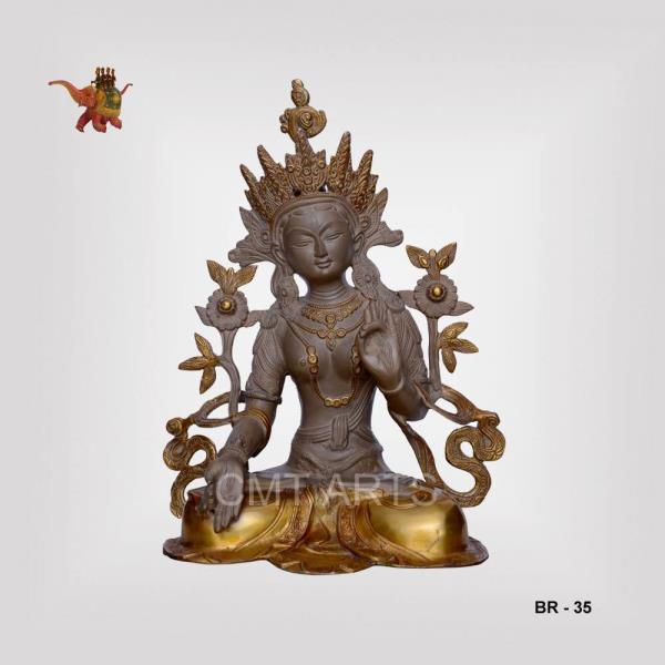"""The Tara statue is brass made. The statue has been made with elaborate detailing which is certainly captivating.  The color is chocolate brown and the detailing has been done with golden color which gives it an ancient look. The calm expression is splendid. The size is 15"""". It can be availed for wholesale rates.   # Indian Handicraft # Hand made # Handicraft at wholesale price"""