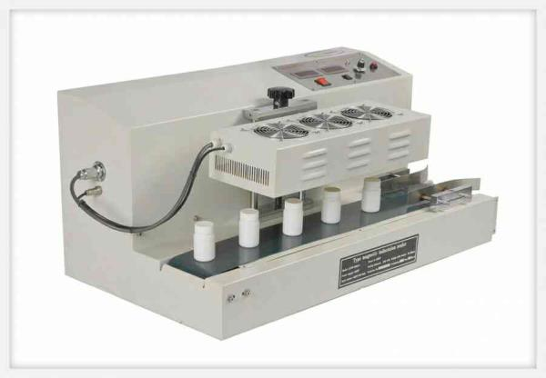 Continuous Induction Sealing Machine-Table Style  Ace Finepack presents The LGYF-1500A-I table-style continuous induction sealing machine that  is highly suitable for capping operation of flat-capped small bottleneck with thread that is mad - by Ace Finepack Private Limited, Ernakulam
