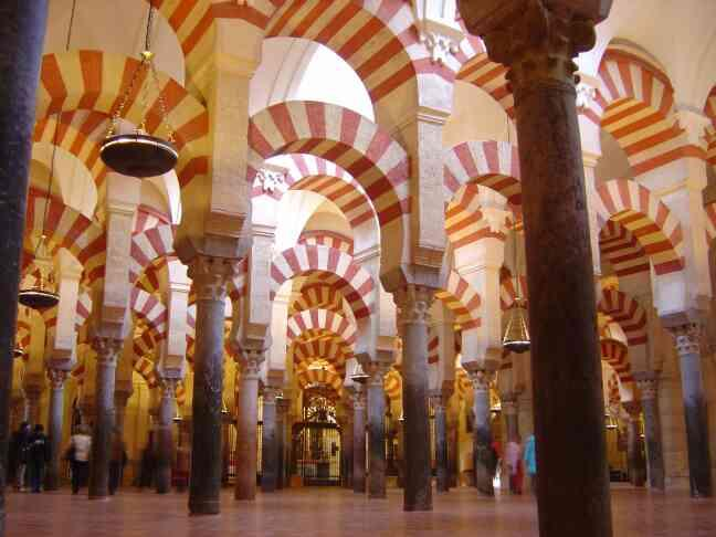 Travel Agent in South Delhi, Delhi.  The Mezquita of Cordoba Is a fascinating building famous for the forest of pillars and arches inside the main hall. The site was originally a Roman temple, then a Visigothic church, before the Umayyad mo - by Karavan Holidays  +919810060052, Delhi