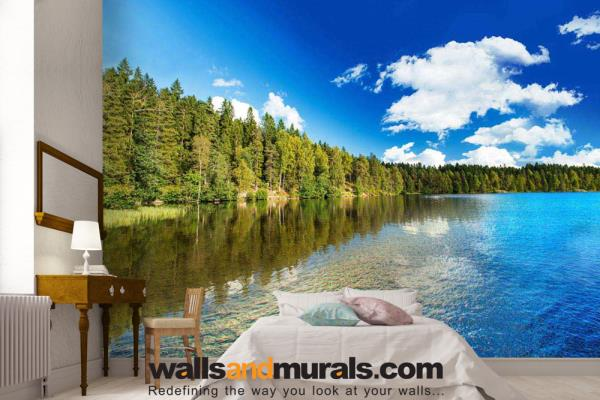 A beautiful lake side landscape from Portland, this Custom Wallpaper can brighten up any environment. The strong colors in this image and beautiful row of trees with reflection in the water leave a mesmerizing effect on everyone.   For More - by Walls and Murals, New York