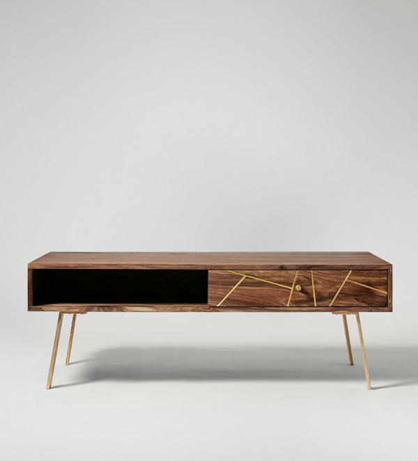 TV Console, Brass legs and sheesham wood frame enhance decoram of your living room. 2 partition one drawers and one one shelf. To keep your stuff inside to it.  Natural finish shows precious wood grains of sheesham wood. That allow looks to be more appealing. Best of collection till date