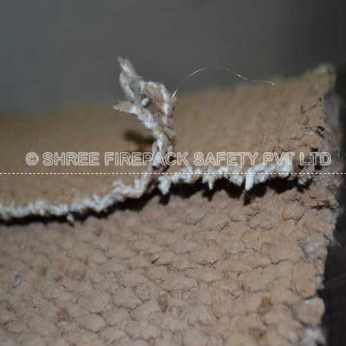 Vermiculite coated ceramic cloth from shree firepack safety pvt ltd.  High temperature ceramic fabric in a variety of weaves, widths, and weights - customized as desired. This will not affect the ceramic fiber properties in Vermiculite coating provided to ss wire insert.