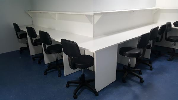 Office tables in a line placed in right angles as per the space available.