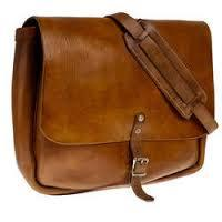#Leather Bags Manufacturer  Slim, compact case is perfect for carrying laptops. Includes padded shoulder adjustable strap