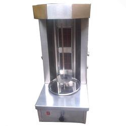 Manufacturers Of Shawarma Machine in Sakinaka, Andheri, Mumbai.Maharastha  We specialize in providing our clients Shawarma Machine that is designed ergonomically as per the set industry standards. Making use of excellent quality material and advance techniques, we ensure robust construction and durability of these machines. Besides, we offer these machines in varied power capacities and dimensions.