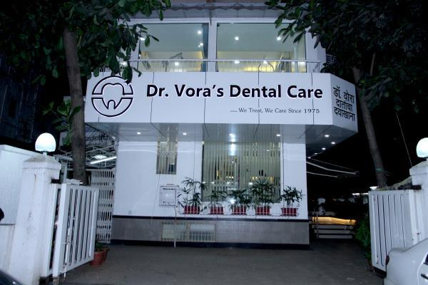 Welcome to Dr. Vora's Dental Care   The smile is the center of our expression. Choosing the right dentist is an important task. We've designed our web site to make your decision easier. Our primary concern is to make you feel confident and comfortable. Dr. Vora & his team are ready to give you and your family the quality dental care you deserve. At Dr. Vora's Dental Care Centre, there is marriage of art & science, we walk that extra mile to make sure your treatment experience with us is almost pain free.by combining years of professional experience together with the latest technology, treatment approaches and techniques.   Dr. Hiralal Vora was the pioneer in starting specialty dental clinic with the single chair in Mulund, way back in 1975. Presently we have 2000 sq. Feet clinic with 5 individualized Dental Operatories and is regarded as one of the best dental office in the central suburb.   Our goal is to provide each and every patient with an incredible experience under enjoyable and caring environment that far exceeds his/her expectations of what a dental practice is like.   We strive to make our dental practice unique by providing outstanding clinical skills, exceptional patient service, leading edge dental technology, materials and equipment and all within an atmosphere that is warm, friendly and relaxed. The goal of our enthusiastic and dedicated staff is to create extremely satisfied patients with wonderful smiles and excellent bites. What we believe is that a beautiful smile can brighten your life and those strong teeth and gums are essential to your overall good health.   Our Expertises in Dentist tratments-  1 Dentist  2 Dental Surgeons  3 Orthodontist  4 Pedodontist  5 Dental X Ray Centre  6 Paediatric Dentistry  7 Oral Surgeon  8 Prosthodontist  9 Periodontist  10 Implantologist  11 Endodontist  12 Maxillofacial Surgeon  13 Oral Maxillofacial  14 Gums Specialist  15 Root Canal Doctor  16 Dental Stemcell Bank  17 Invisible Dental Braces  18 Doctors For Invisible Braces  19 Invisalign  20 Orthodontist Doctors For Clear Aligners  21 Lingual Orthodontist  22 24 Hours Dentist  23 Smile Improving Technique  24 Braces Fitting  25 gummy smile correction  26 braces specialist  27 wisdom tooth surgeon  28 Dental OPG in mulund  29 comfortable braces  30 Dental implant specialist  31 Smile makeover  32 Smile correction  33 Invisible braces  34 kids Dental specialist  35 kids dentist  36 bad breadth treatment  37 halitosis treatment  38 dental veeners / veneers  39 ceramic braces specialist  40 metal braces in mulund  41 crystal braces  42 crocked teeth correction  43 tongue thrust correction  44 thumb sucking habit  45 space maintainer  46 teeth fluoride treatment  47 dental sealant  48 cavity filling  49 Dental filling  50 composite filling  51 Dental braces cost  52 Dental Implant cost  53 smile enhancement cost  54 smile enhancement treatment  55 bleeding gums  56 pyorrhea treatment  57 mouth ulcer  58 oral cancer treatment  59 cleft lip and palate specialist  60 orthognathic treatment  61 face lift surgery  62 face botox treatment  63 plastic surgery  64 double chin treatment  65 Botox treatment  66 oral lesion  67 burning mouth treatment  68 mouth breathing  69 night grinding  70 bruxism treatment  71 TMJ pain  72 pain in jaw joint  73 headache treatment  74 wisdom tooth pain  75 night guard  76 sports mouth guard  77 tooth replacement  78 denture  79 fixed denture  80 ceramic teeth  81 composite filling  82 dental retainers  83 fixed retainers  84 removable retainers  85 tooth colour filling  86 tooth jewellary  87 dental jewellary  88 cosmetic dentisrty  89 teeth whitening  90 power whitening  91 one hour whitening  92 braces care  93 types of braces  94 braces emergency  95 advanced braces  96 speed braces  97 mouthwash for braces  98 milk teeth treatment  99 nursing bottle cavity  100 baby bottle syndrome  101 first dental check up  102 pit and fissure sealant  103 tooth sensitivity  104 teeth sensitivity  105 bleeding gums  106 tooth ache  107 tooth extraction  108 surgical extraction  109 wisdom tooth surgery  110 wisdom tooth problem  111 pericoronitis  112 tooth abcess  113 tooth pus  114 pain on chewing  115 teeth sensitivity with hot  116 teeth sensitivity with cold  117 dental enamel  118 hypersensitivity to cold  119 hypersensitivity to hot  120 dental nerve  121 dental cleaning  122 teeth stains  123 tobacco stains treatment  124 cigarette stains  125 teeth cleaning  126 teeth polishing  127 teeth scaling  128 dental cleaning  129 fixed teeth  130 diastema treatment  131 spacing in teeth  132 protruding teeth  133 broken tooth  134 trauma to teeth  135 full mouth rehabilitation  136 biological dentist  137 whitening toothpaste  138 teeth bleaching  139 teeth whitening  140 receding gums  141 black gums  142 jaw swelling  143 swollen gums  144 best fluoride toothpaste  145 best kids toothpaste  146 tooth/teeth injury  147 single sitting root canal  148 single visit root canal  149 snoring treatment  150 mouth breadthing  151 jaw growth issue  152 small jaw correction  153 impacted tooth  154 sleep apnea treatment  155 surgical correction for snoring  156 surgical correction for sleep apnea  157 missing teeth/ tooth  158 night grinding  159 morning headache  160 clicking sound in jaw  161 Damon braces  162 self ligating braces  163 lingual invisible braces  164 tooth/teeth Implant  165 jaw fracture  166 jaw tumor  167 chipped tooth  Damon braces   Self ligating braces   Lingual invisible braces   Tooth/ teeth implant   Jaw fracture   Jaw tumour   chipped tooth   Single visit implant   Dry mouth treatment   Teething symptoms   Emergency treatment for avulsion   Gum pigmentation treatment   Brushing technique   How to brush   Clove oil for tooth pain relief   Home remedies for tooth pain   Home remedies for teeth whitening   Home remedies for bleeding gums   Home remedies for bad breath   Home remedies for teeth sensitivity   Shining teeth dentist  Dental specialist   Difficult tooth extraction specialist   Behind tooth extraction specialist   Good dental clinic in Mulund   Smart dentist in Mulund   Best Dental clinic in Mulund   Ceramic braces specialist   Dento- Orthopedic specialist   Maxillofacial surgery specialist   Full mouth rehabilitation specialist   Full mouth crown specialist   Gum surgery   Fluoride application in children   Cleaning teeth in children   Black teeth in children   Tooth advice in children   incognito braces   invisaline dentist   dental ozone therapy   clear aligners dentist   aligner dentist   fixed retainer   removable retainer   lingual retainer   gaps in teeth   total dental care   best dental clinic    For more information please visit our clinic at,  1, Pearl Center,  At Junction of J.N Rd. & Goshala Rd.,  Opp. HDFC Bank,  Mulund (West),  Mumbai - 400 080.  Or Call us at,  (+91 22) 2567 8000 / 01 (+91 22) 2567 8468  Or visit our  website www.drvorasdental.com OR www.dentistmumbai.in  Our Like our Facebook Page  Dr. Vora's Dental Care https://www.facebook.com/Dr.VorasDentalCare/