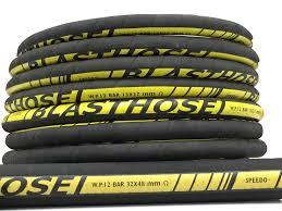 Shot Blasting Hose Manufacturer  A long-lasting heavy-duty hose exceptionally tough and abrasion resistant, for use in sand and steel blasting service; it is manufactured with anti-static rubber granting a complete discharge of static electricity. Temperature range: -40 degree C (-40 degree F) to 70 degree C (+158  degree F) Tube: Black, smooth with excellent resistance to abrasion; it is anti-static. Reinforcement: High strength synthetic cord. Cover: Black, smooth (wrapped finish) highly abrasion resistant synthetic rubber; it is anti-static. Coils: 15 mt continuous length  With the support of our experienced professionals, we are able to manufacture, export and supply high-grade Sand/Shot Blast Hose. These hoses are used to convey sand in high speed and pressure in steel manufacturing workshops and ordnance factoring. The hose, which we offer are extensively used in construction, quarries, water supply and irrigation projects as these hoses are lighter than conventional rubber. The Sand/Shot Blast Hose is made using natural rubber compounds, therefore these are very strong and has a smooth lining.  Construction:     Tube:Extra thick seamless tube of soft natural rubber compound of high tensile strength, excellent abrasion resistant and free from any mineral filler.  Reinforcement: Plies of woven textile of high strength natural or synthetic fibre  Electrical Bonding: Low resistant electrical bonding wire incorporated between the reinforcement plies to provide electrical continuity along the whole length of the hose. .  Cover: Natural or Synthetic Rubber, Cloth marked finish.  This hose is used for Sand/Shot blasting applications for conveying sand and other abrasive materials at high velocity in heavy engineering industries, ordnance factories etc.