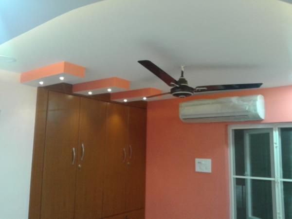 False ceilings serve the dual purpose of beautification and energy efficiency. A well-designed false ceiling, with the right kind of lighting not only enhances the beauty of your room, but also brings down your electricity bill. This photo is of the false ceiling in one of our projects in T Nagar.