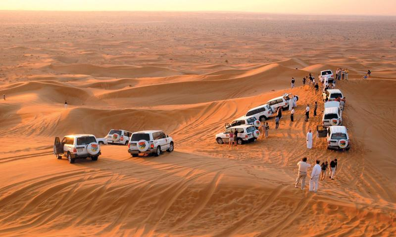 When in Dubai, Enjoy 5 hour Dubai Desert Safari Tour which is the ideal tour for any visitor to Dubai. Have an adventure ride in Land Cruiser in the sandy and golden landscape of the desert followed by BBQ dinner, Belly Dance and Tanoura sh - by Tourient Travel Services | Best Tour Packages, Anand