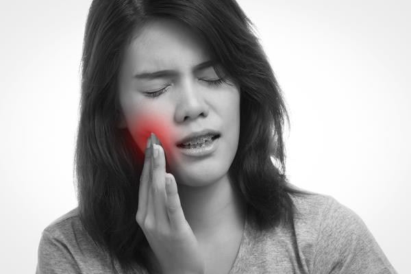 Sensitive teeth:  It's common for hot and cold foods to trigger mild tooth sensitivity, but if you have pain in some specific tooth only along with other symptoms – such as loose teeth, swollen gums or pain while chewing – you may have extremely sensitive teeth caused by another dental issue.like....  Tooth cavity due to deep decay  Abrasion of teeth  Erosion of teeth  Broken tooth  gums diseases  to find out reason for your teeth sensitivity call our dental expert on 02225678000 for an appointment .