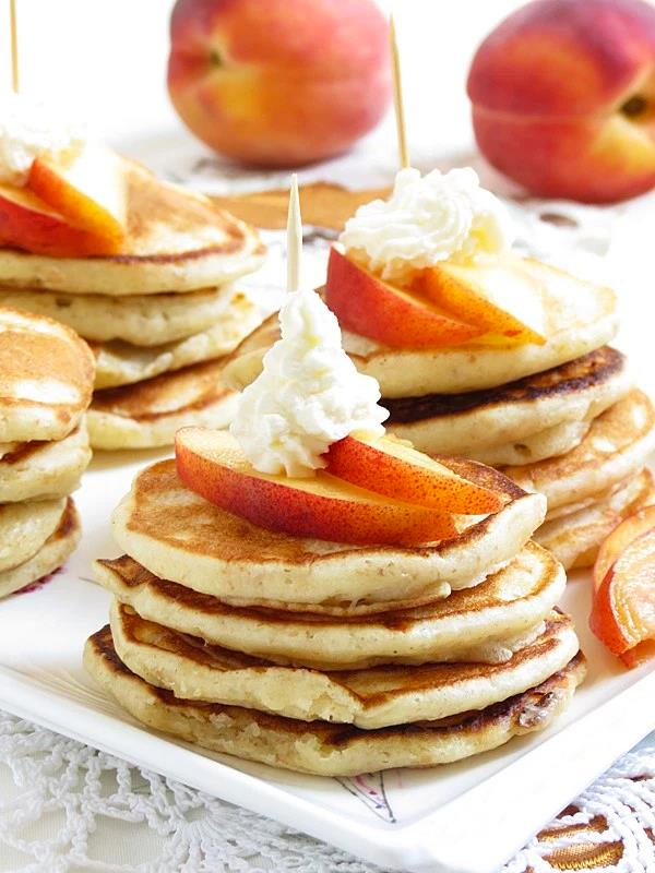 PEACHES AND CREAM MINI PANCAKES {PARTY STYLE}  Peaches and Cream Mini pancakes topped with seasonal peaches, whipped cream and maple syrup. Perfect for a Tea Party or a Brunch! Lately, I was thinking how to change my blog a little. I've dec - by Technews us, Kolkata