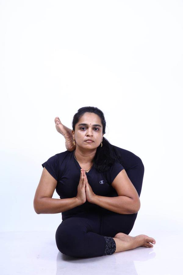 Yoga for back pain and neck pain in lakshmi andiappan yoga